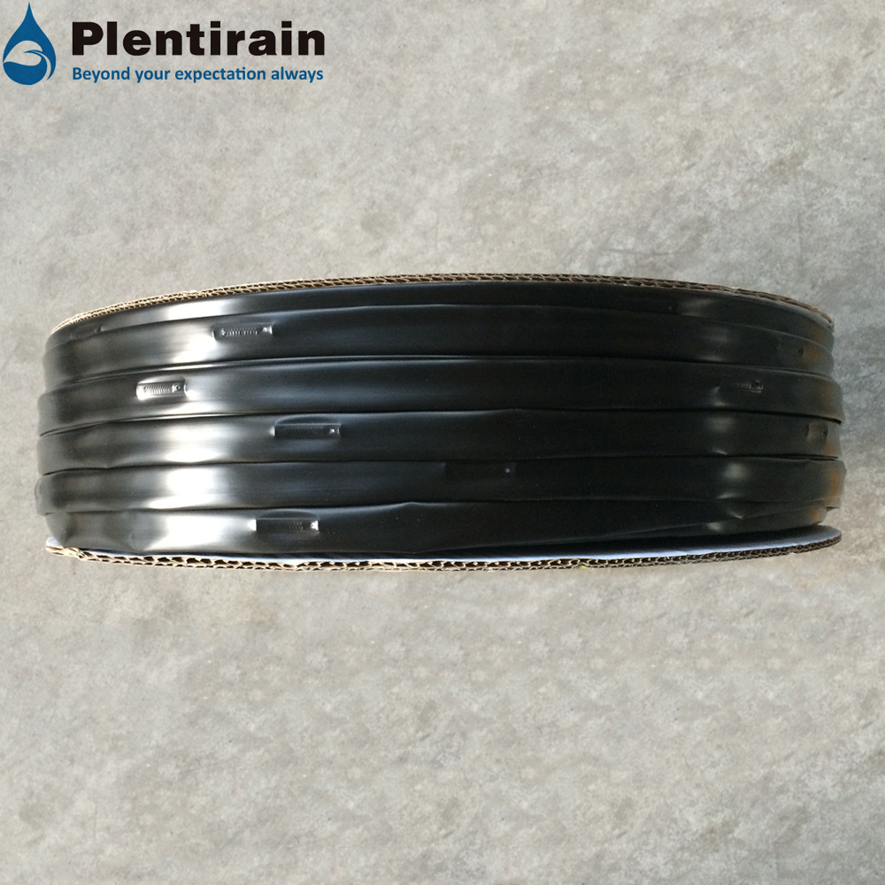 Flat emitter drip irrigation emitting pipe